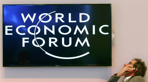 Participant speaks on his mobile phone between sessions during World Economic Forum in Davos