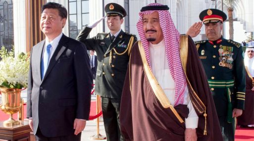 "A handout picture provided by the Saudi Press Agency (SPA) on January 19, 2016 shows Saudi King Salman bin Abdelaziz (R) and Chinese President Xi Jinping listening to their national anthems upon Xi's arrival in Riyadh. Xi arrived in Saudi Arabia, the first stop on a trip to raise the economic giant's political profile in a troubled Middle East.  - RESTRICTED TO EDITORIAL USE - MANDATORY CREDIT ""AFP PHOTO / SPA"" - NO MARKETING NO ADVERTISING CAMPAIGNS - DISTRIBUTED AS A SERVICE TO CLIENTS  / AFP / SPA / STRINGER / RESTRICTED TO EDITORIAL USE - MANDATORY CREDIT ""AFP PHOTO / SPA"" - NO MARKETING NO ADVERTISING CAMPAIGNS - DISTRIBUTED AS A SERVICE TO CLIENTS"