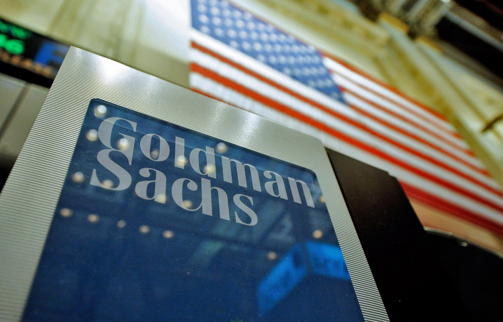 epa04024436 (FILE) A file photo dated 19 January 2011 showing a sign at the Goldman Sachs both on the floor of the New York Stock Exchange after the Opening Bell in New York, New York, USA. Goldman Sachs Group, Inc. on 16 January 2014  reported net revenues of $34.21 billion and net earnings of $8.04 billion for the year ended December 31, 2013. Diluted earnings per common share were $15.46 compared with $14.13 for the year ended December 31, 2012. Return on average common shareholders' equity (ROE) (1) was 11.0 per cent for 2013. Fourth quarter net revenues were $8.78 billion and net earnings were $2.33 billion. Diluted earnings per common share were $4.60 compared with $5.60 for the fourth quarter of 2012 and $2.88 for the third quarter of 2013.  EPA/JUSTIN LANE *** Local Caption *** 50399116