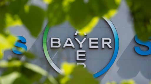 (FILES) This file photo taken on July 24, 2013 shows a logo of German pharmaceuticals and chemicals giant Bayer on an overpass at its Berlin headquarters. Shares in Bayer slid by seven percent at the start of trade on May 19, 2016 after the company said it was in merger talks with US agricultural firm Monsanto. / AFP / JOHN MACDOUGALL