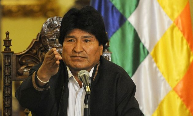 Bolivian President Evo Morales is seen during a press conference at the Government Palace in La Paz on December 26, 2014.  AFP PHOTO/Jorge Bernal