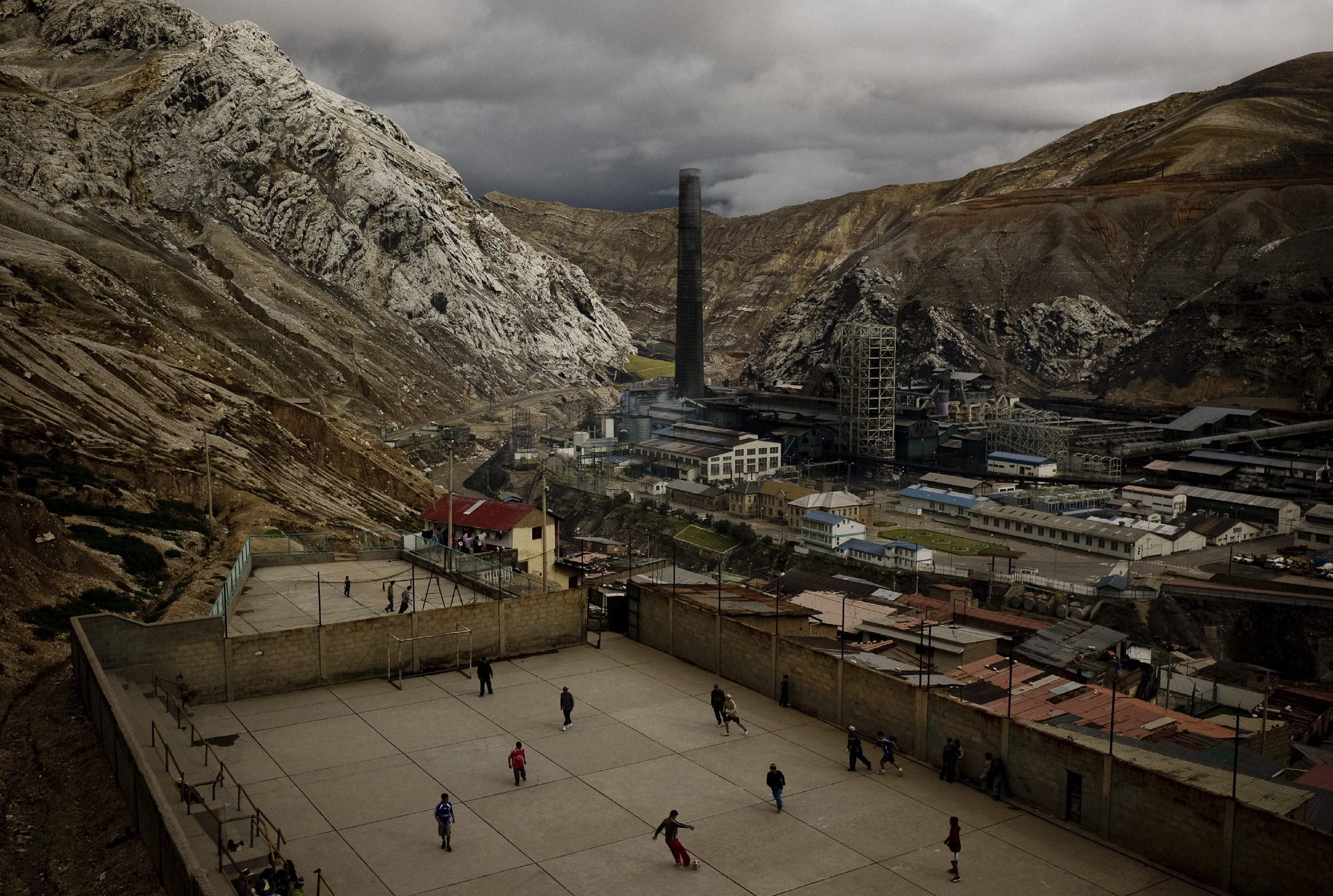 Youth play soccer in La Oroya next to the American-owned smelter Doe Run Peru. This photo was taken in April 10, 2009, when production was almost completelly suspended due to an allegedly financial crisis in the company, now it is still closed. The company claims that it was not able to carry out its environmental program in violation of its agreement with the goverment, arging economic reasons, but for years it was operating in defiant of enviromental regulations, in a city where many children have tested for high lead levels in their blood due to smelter pollution.