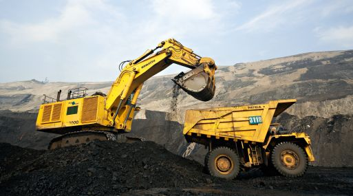 An undated handout photograph shows Komatsu Ltd. heavy machinery extracting coal on a PT Adaro Energy coal mine in Indonesia, provided to the media on Monday, Nov. 24, 2008. PT Bumi Resources and rival PT Adaro Energy may announce third-quarter earnings by Nov. 30, the deadline for the release of the data. Source: PT Adaro Energy via Bloomberg News  EDITOR'S NOTE: EDITORIAL USE ONLY. NO SALES. NO ARCHIVING.