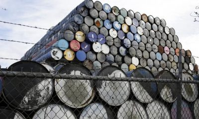 Used oil barrels are stacked at a storage facility in Seattle, Washington February 12, 2015. REUTERS/Jason Redmond